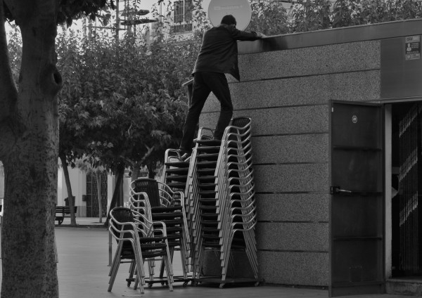 Man on chairs