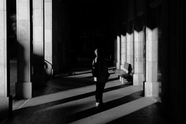 Woman between shadows