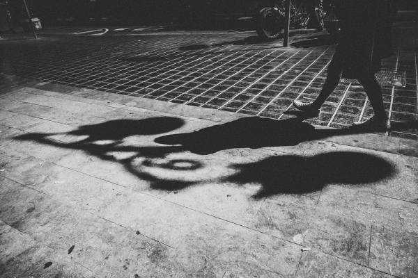 Shadow of woman on pavement