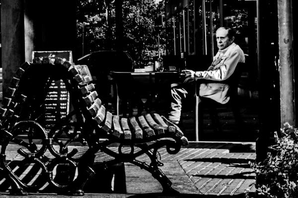 Man sitting on terrace of bar