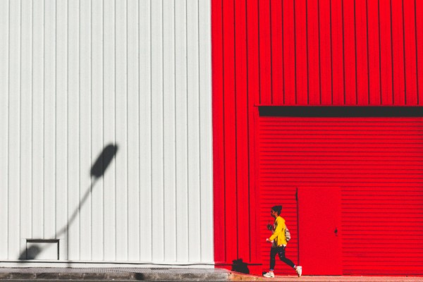 Girl in yellow on red-white wall