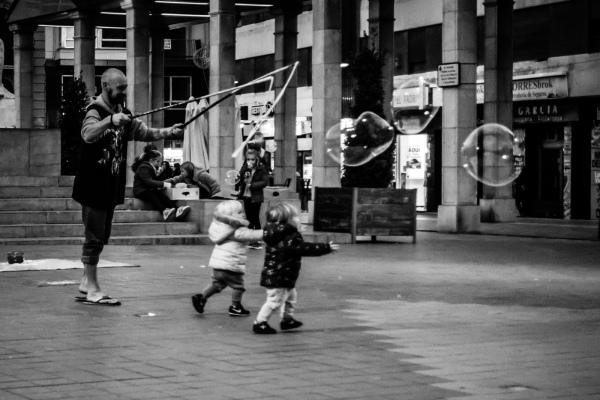 square, children pursuing bubbles